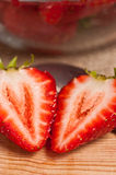 Halved Strawberry on cutting bosrf Stock Images