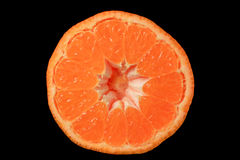 The halved Tangerine on the black Background Royalty Free Stock Images