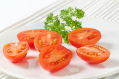 Halved tomatoes Stock Photo