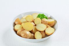 Halved unpeeled potatoes Royalty Free Stock Photos