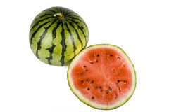Halved watermelon. Overhead view of halved watermelon showing top and bottom, isolated on white background Royalty Free Stock Image