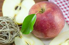Halved and whole apple Royalty Free Stock Images
