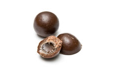 Halved and a whole chocolate ball Royalty Free Stock Photography