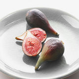 Halved and Whole Figs  Stock Photo