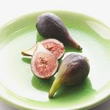 Halved and Whole Figs Royalty Free Stock Photo