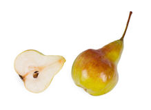 Halved and whole fresh ripe pears Stock Images