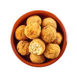 Halved and whole fried bacalao croquettes Stock Photography