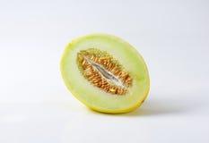 Halved yellow melon Stock Photos