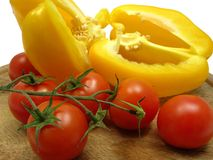 Halved yellow pepper and tomatoes Stock Photo