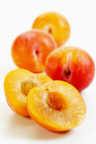 Halved yellow plums Royalty Free Stock Images