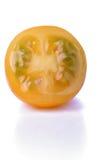 Halved yellow tomato on white background Stock Image