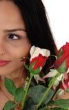 Halvera av en framsida av en kvinna med rosor Arkivbilder