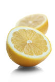 Halverad citron på vit bakgrund Royaltyfria Foton