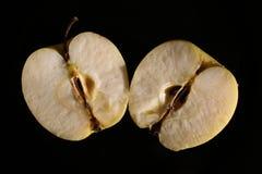 Halverat äpple på svart ställe royaltyfria foton