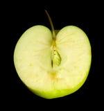 Halverat grönt äpple arkivfoto