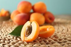 Halves of apricot. On wicker mat royalty free stock photos