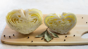 Halves of cabbage in shape of hearts. Creative food concept. Light background royalty free stock images