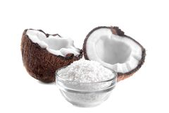 Halves of coconut with coconut shaving isolat. Halves of coconut with coconut shaving on white background isolated royalty free stock images