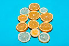 Halves of different fruits. Halves of different fruit lying next to each other royalty free stock images