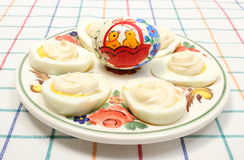Halves of eggs with mayonnaise and painted egg Royalty Free Stock Images