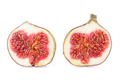 Halves of a Figs Fruits. Two Halves of a Figs Fruits isolated on white royalty free stock images