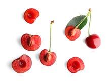 Halves of fresh sweet cherry. On white background stock images