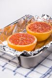 Baked halves grapefruit. Halves grapefruit baked in the oven royalty free stock image