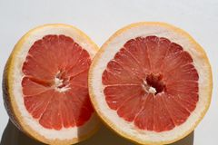 Halves of a grapefruit on a white background stock image