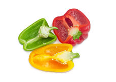 Halves of green, yellow and red fresh bell peppers Royalty Free Stock Images