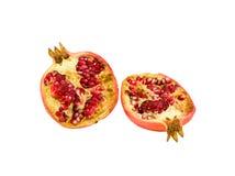 Halves of juicy pomegranate. Isolated on white background royalty free stock photo