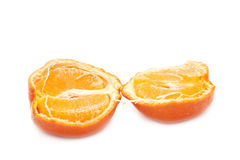 Halves of mandarin. Two halves of mandarin against the white background Stock Image