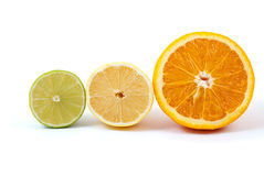 Halves of orange, lemon and lime. Isolated on the white background Stock Images