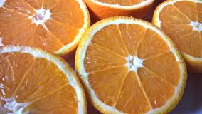 Halves of oranges. Close-up of few juicy and fresh oranges cat to half royalty free stock image