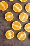 Halves of oranges on a dark. royalty free stock photography