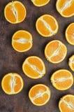 Halves of oranges on a dark. stock image