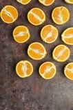 Halves of oranges on a dark. Halves of oranges on a dark brown background royalty free stock photo