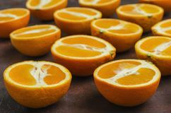 Halves of oranges on a dark. stock photo