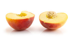 Halves of peach Royalty Free Stock Image
