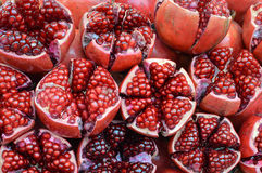 Halves of pomegranates with seeds sold in the local market of Bangko. Fresh pomegranates with seeds sold in the local market of Bangkok, Thailand stock photography