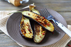 Halves roasted eggplant Stock Photos