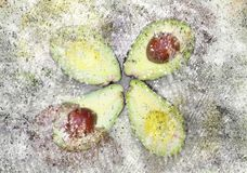 Halves sliced avocado with explosion effect background royalty free stock image