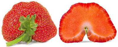 Halves strawberries. Red strawberry cut into two slices, isolated on white background Royalty Free Stock Photo