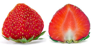 Halves strawberries1. Red strawberry cut into two slices, isolated on white background Royalty Free Stock Images