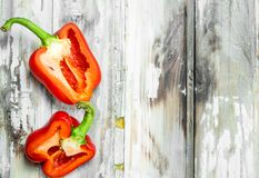 Halves of sweet fresh pepper. On wooden background stock photography