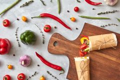 Halves of vegetable burrito on a wooden board Royalty Free Stock Photos