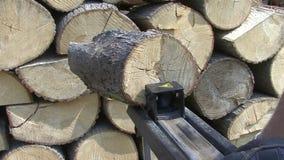 Halving hydraulic log splitter stock video