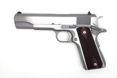 Halvt-autometic vapen på vit bakgrund Arkivfoton