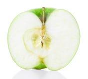 Halvt grönt äpple royaltyfria bilder