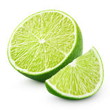 Halvt och skiva av limefruktcitrusfrukt som isoleras på vit royaltyfri bild