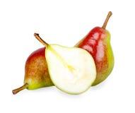 Halvt päron på bakgrunden av de två päronen Arkivfoton